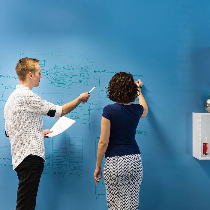 Smart wall paint clear in use on blue wall