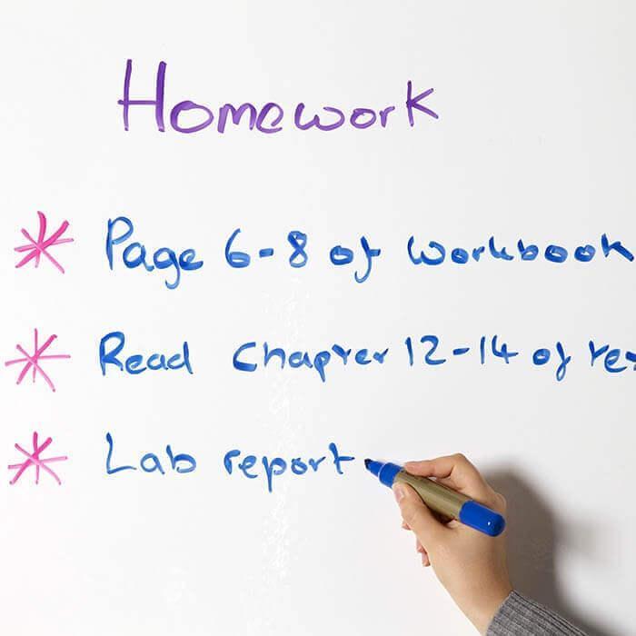 Homework being written on Smart Magnetic Whiteboard Wallpaper